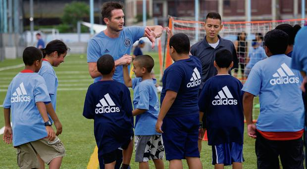 Frank Lampard speaks to children in New York after being introduced as a member of the MLS expansion club New York City
