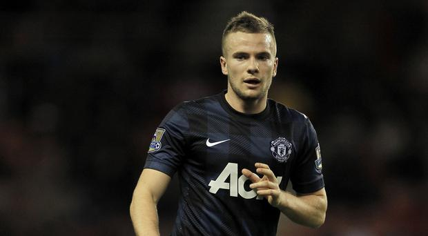 Tom Cleverley, pictured, is pleased Ryan Giggs is staying at Old Trafford as a part of the club's coaching staff