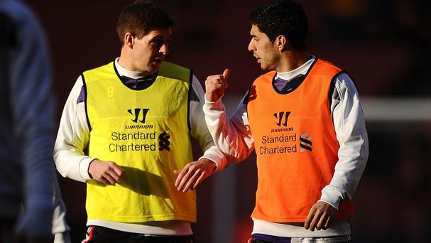 Luis Suarez, right, was warned off a move to Arsenal by Steven Gerrard, left
