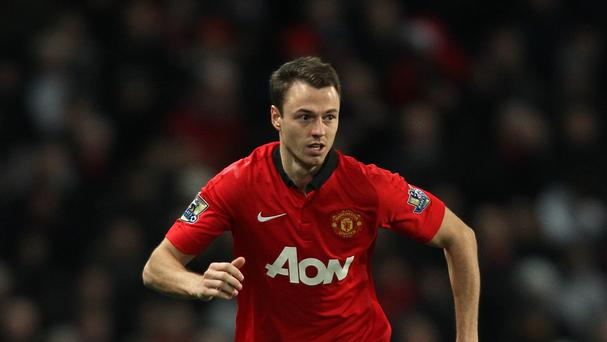 Jonny Evans, pictured, is happy to abide by Louis van Gaal's demanding methods