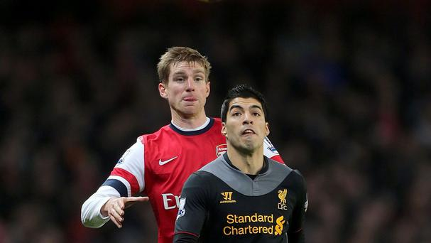 Luis Suarez, right, was targeted by Arsenal last summer