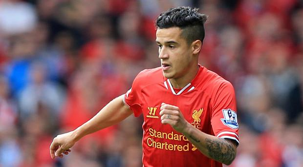 Brendan Rodgers wants to Philippe Coutinho, pictured, rewarded for his form