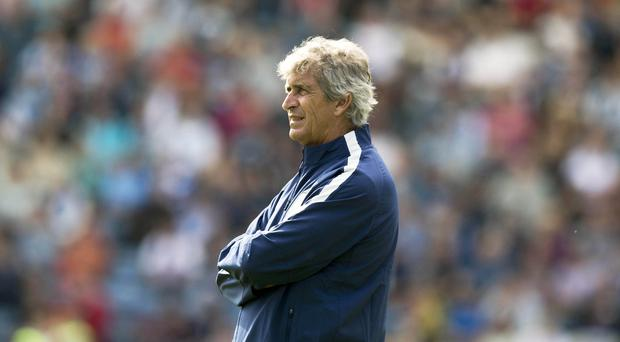 Manchester City manager Manuel Pellegrini is happy with the club's signings