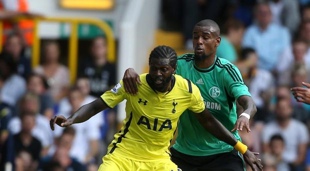 Emmanuel Adebayor, left, battles during Tottenham's friendly against Schalke