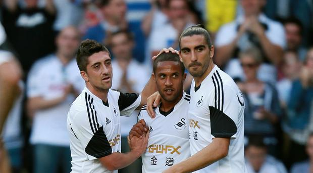 Both Pablo Hernandez, left, and Chico Flores, right, have left Swansea