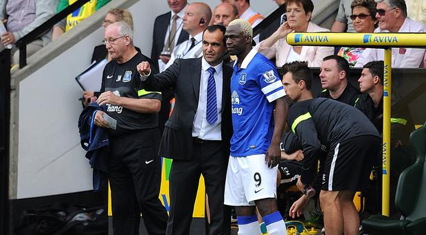 Roberto Martinez, left, is confident striker Arouna Kone, right, will prove his worth after a long injury lay-off