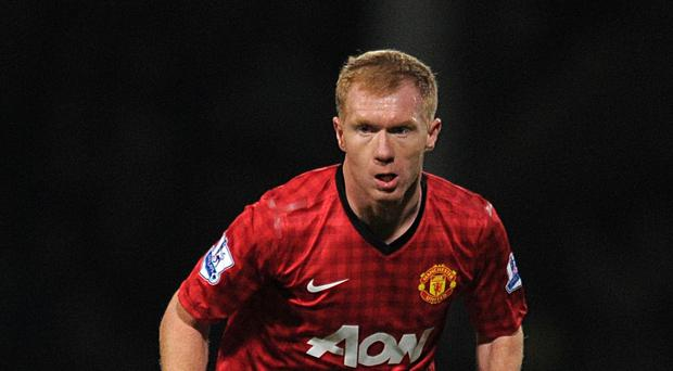 Paul Scholes believes Manchester United lack a world-class midfielder