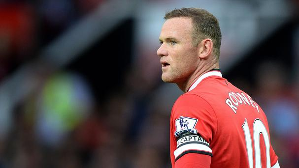 Wayne Rooney leads Manchester United into the new season