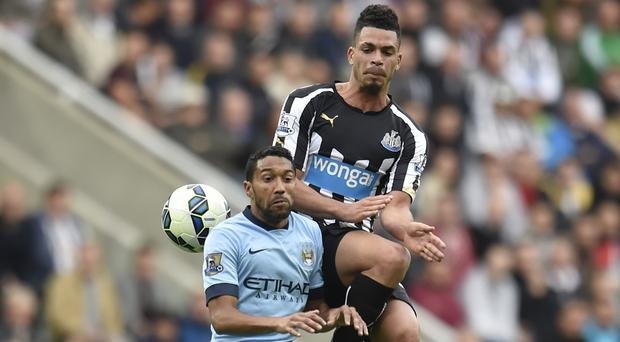 Gael Clichy, pictured left, had a tough afternoon dealing with Newcastle striker Emmanuel Riviere