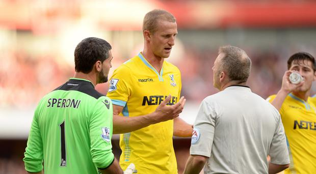 Brede Hangeland, centre, has decided to focus all of his attention on club football