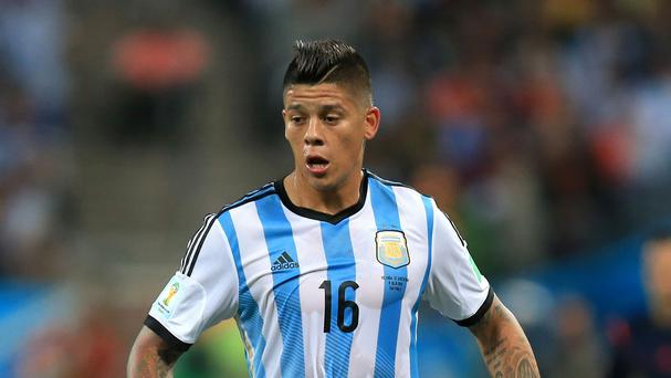 Left-back Marcos Rojo is on his way to Old Trafford