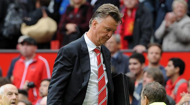 Former Manchester United striker Andy Cole says manager Louis van Gaal, pictured, must buy more players
