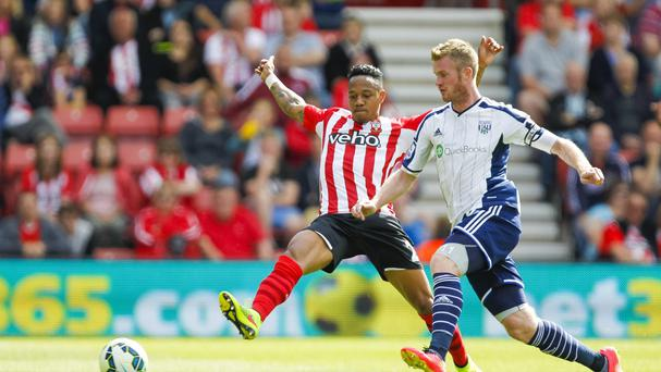Southampton's Nathaniel Clyne, left, and West Brom's Chris Brunt battle for the ball