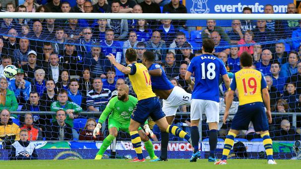 Olivier Giroud, centre, scores Arsenal's late equaliser against Everton