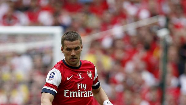 Lukas Podolski's agent has denied that the player is set to leave Arsenal