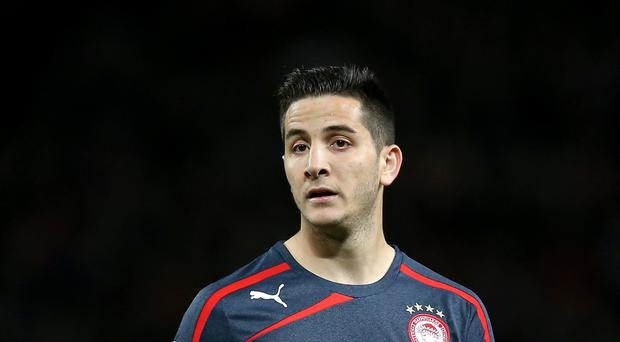 Arsenal-linked Kostas Manolas is reportedly in Italy for a medical with Roma