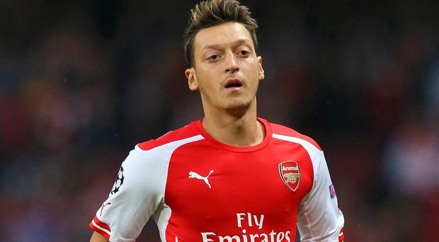 Mesut Ozil, pictured, deserves more praise, according to Arsene Wenger