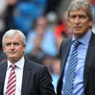 Mark Hughes, left, feels the result will kickstart Stoke's campaign