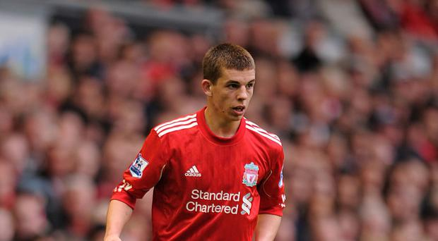 Jon Flanagan is determined to get back into the Liverpool side.