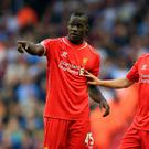 Liverpool's Mario Balotelli and Adam Lallana (right) during the Barclays Premier League match at Anfield, Liverpool.