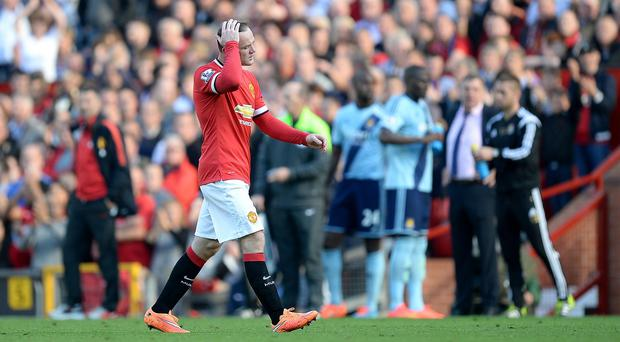 Manchester United's Wayne Rooney leaves the pitch after receiving a red card