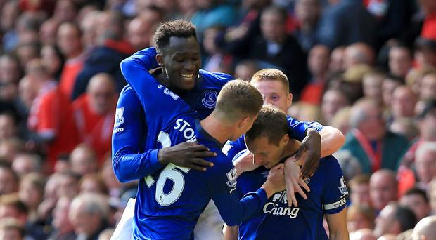 Phil Jagielka is mobbed by team-mates after earning Everton a point at Anfield