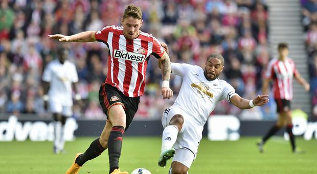 Connor Wickham (left) has been backed by Sunderland head coach Gus Poyet