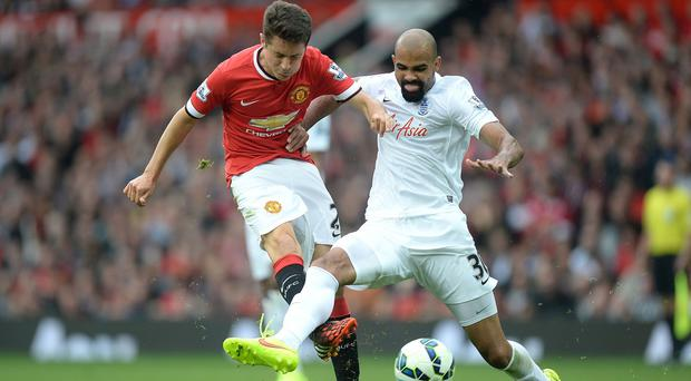 Harry Redknapp has called for changes to concussion rules after Sandro, right, suffered a head injury in QPR action