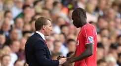 Liverpool boss Brendan Rodgers, left, has no concerns over Mario Balotelli, right