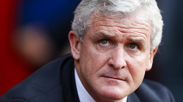 Stoke boss Mark Hughes, pictured, has stressed now is not the right time for discussions with Chelsea about whether Victor Moses might stay with the Potters beyond his current loan deal