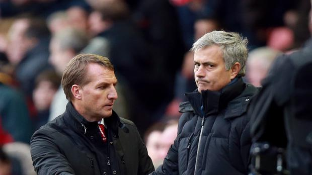 Brendan Rodgers, left, felt Liverpool were denied a 'clear' penalty against Jose Mourinho's Chelsea