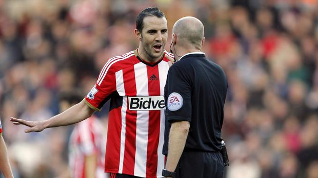 John O'Shea led Sunderland's protests after the penalty decision