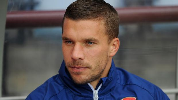 Lukas Podolski is not happy with his role at Arsenal