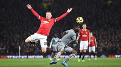 Wayne Rooney, left, enjoyed the role of leading Manchester United's midfield against Newcastle