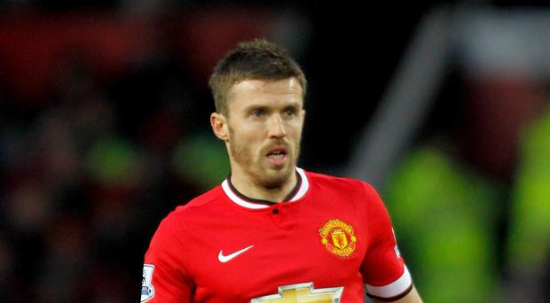 Manchester United's Michael Carrick will miss the visit to Stamford Bridge