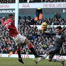 Hugo Lloris, right, was the hero for Tottenham, seen here blocking a Robin van Persie shot