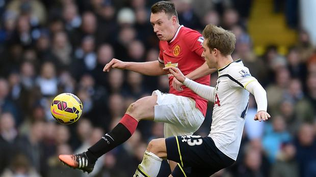 Phil Jones, left, believes poor finishing was more of a factor than tiredness in the draw against Tottenham