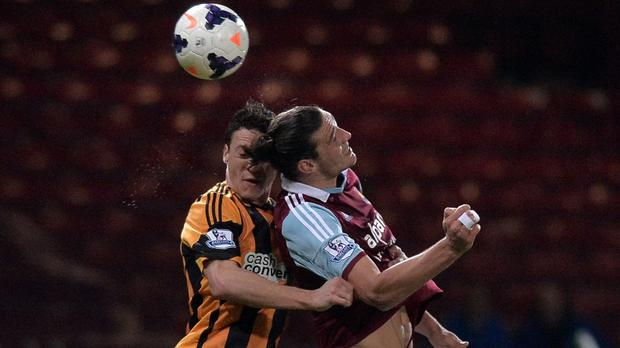 James Chester, left, and Andy Carroll, right, are likely to face one another at Upton Park on Sunday