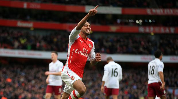 Theo Walcott believes Arsenal are hitting top form at an ideal time