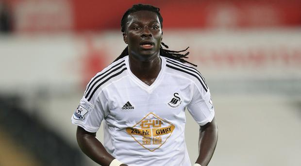 Swansea striker Bafetimbi Gomis has ended weeks of speculation about his future by declaring he will be staying at the club