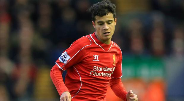 Brendan Rodgers believes Philippe Coutinho, pictured, can become a playmaker on the level of Luka Modric or Toni Kroos