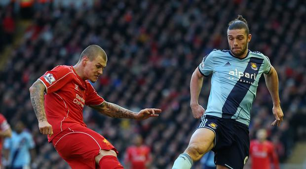 Andy Carroll, right, suffered an ankle injury against Liverpool