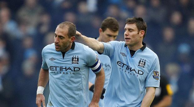 Pablo Zabaleta, left, hopes James Milner stays at Manchester City
