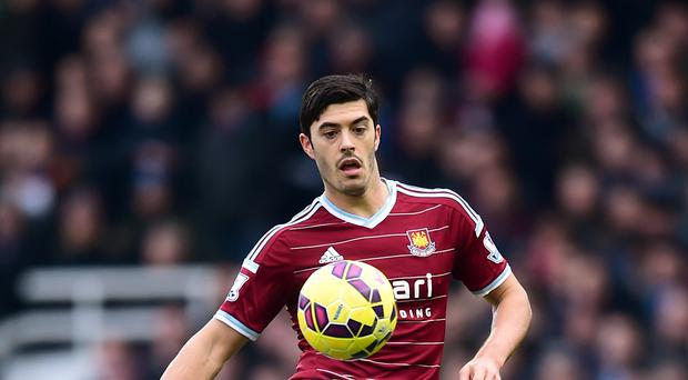 James Tomkins has signed a new contract at West Ham