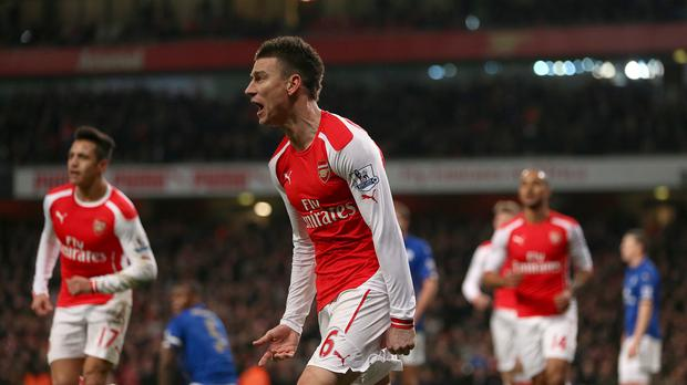 Arsenal's Laurent Koscielny celebrates scoring the first goal of the game