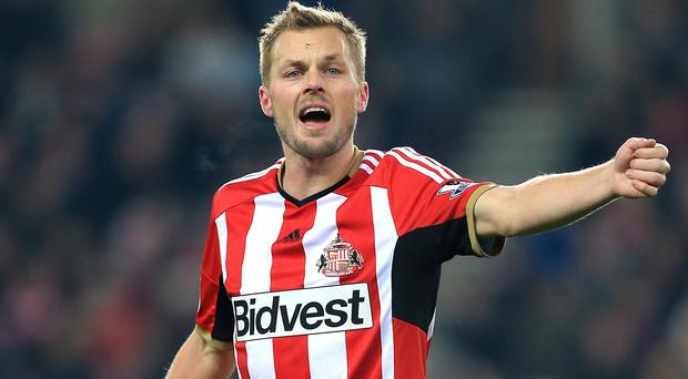 Sebastian Larsson, left, has admitted Sunderland need to shed their capacity to self-destruct if they are to avoid another survival fight