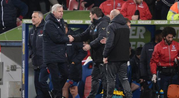 Alan Pardew, pictured second from left, came face to face with his former Newcastle assistant John Carver, second from right