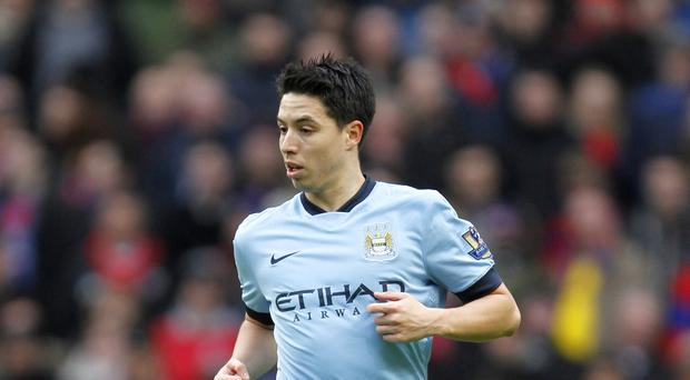 Manchester City's Samir Nasri has no intention of keeping quiet