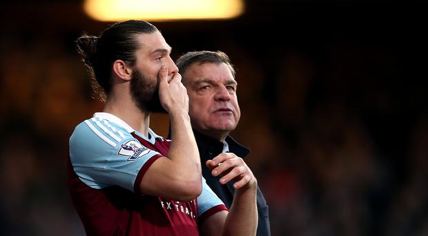 Andy Carroll, left, to miss the rest of the season through injury