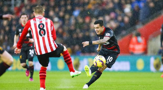 Philippe Coutinho, right, scores Liverpool's first goal from distance against Southampton